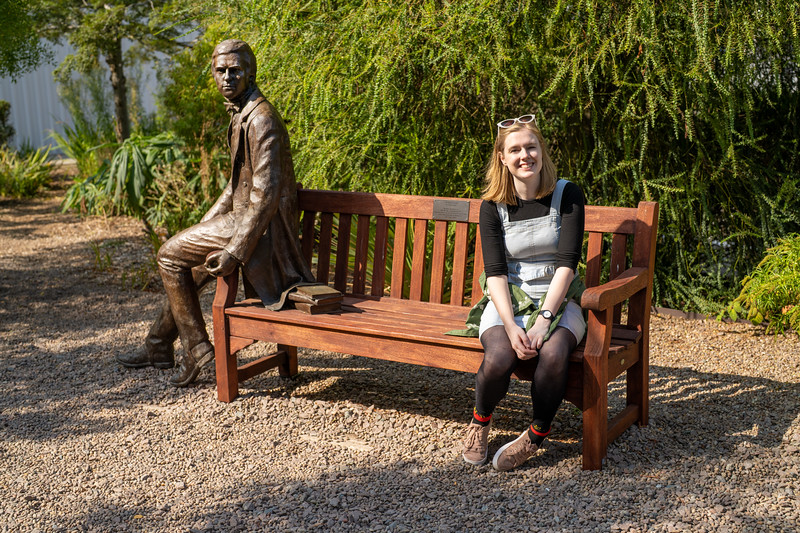 Bethany Heath Sitting Next to the Statue of Charles Darwin (Sep 2021)