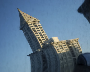 Smith Tower reflected in car window