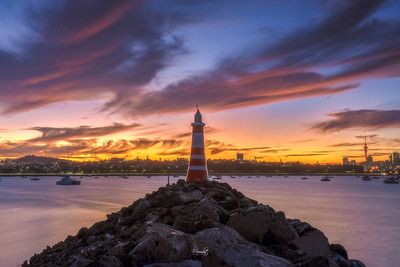 A Lighthouse and the City of Sails