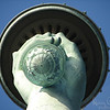Looking directly up at the torch of the Statue of Liberty