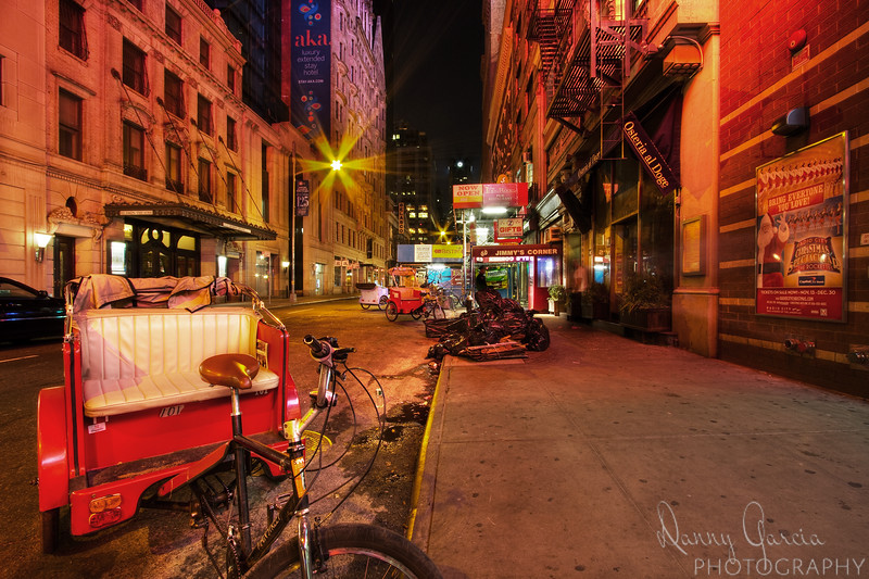 Bikes on 44th Street - As my evening came to an end in New York City, I strolled off of Broadway along 44th Street. I found the bikes that are usually carrying tourists around the city, sitting and waiting to be put away.