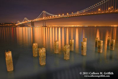 Golden Lights ©  2011 Colleen M. Griffith. All Rights Reserved. This material may not be published, broadcast, modified, or redistributed without written agreement with the creator.  This image is registered with the US Copyright Office.  www.colleenmgriffith.com www.facebook.com/colleen.griffith  You can see more of my San Francisco Bay Bridge shots in my panoramics gallery:  www.colleenmgriffith.com/Galleries/San-Francisco/Panoramics