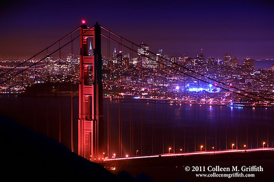 San Francisco Nights Part Deux ©  2011 Colleen M. Griffith. All Rights Reserved. This material may not be published, broadcast, modified, or redistributed  without written agreement with the creator.  This image is registered with the US Copyright Office. www.colleenmgriffith.com www.facebook.com/colleen.griffith  I thought this was another interesting view of San Francisco's skyline and the Golden Gate Bridge.  In this photo, the TransAmerica building is framed within the North Tower of the bridge.  In other photos, I framed the TA Building in the cables of the bridge.  You can also see a portion of the Bay Bridge (upper left background) and the Moscone Recreation Center (bright lights, right-hand center).    You can see a different processing of this photo here: http://www.colleenmgriffith.com/Galleries/New/New-Photos/13407757_C6nwm#1170581569_Xb2YF .   I'd be curious to hear if you like the other version better compared to this one.  Posted 29 January 2011.