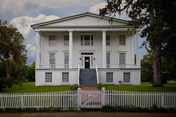 "Orange Hall built in 1830 is a showcase of antebellum life in the Greek Revival style.   The home takes its name Orange Hall from the ""extensive hedges and the large sour orange grove at the rear of the house."