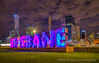 Night shoot of G20 Brisbane sign from Southbank with Brisbane city on background.