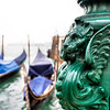 Base of lamp in Venice near a canal