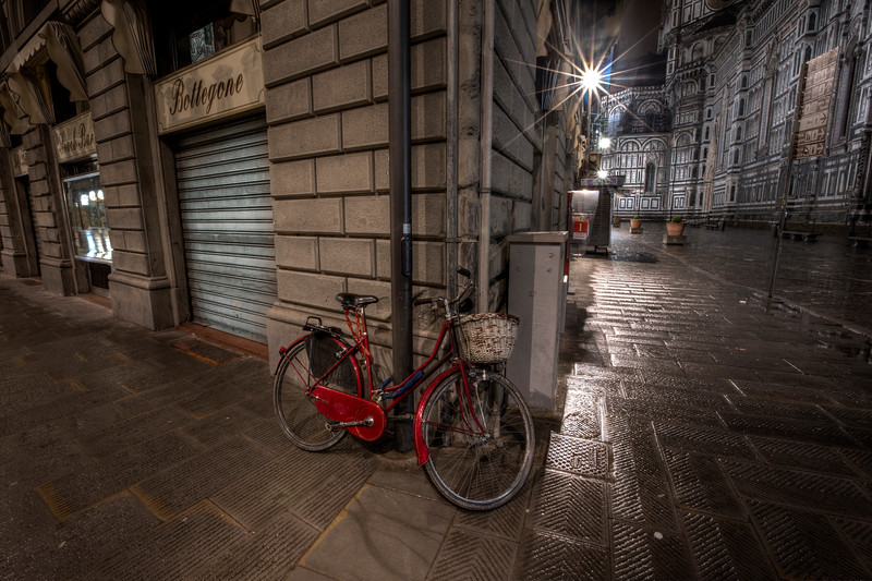 Red Bicycle on a wet street in Florence