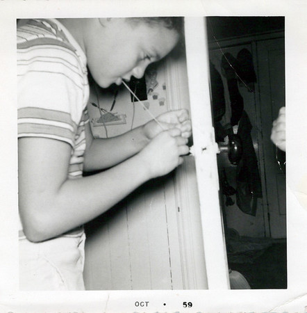1959 Ken removing a tooth