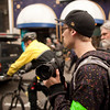 A young Photographer walks through the crowd looking for 'the shot' at the Occupy Portland movement in Portland Oregon.