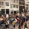 The crowds walk down Broadway at the Occupy Portland movement in Portland Oregon.