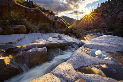 Evening sun illuminates a narrow granite cascade along seasonal Picadilla Creek in the Four Peaks Wilderness.