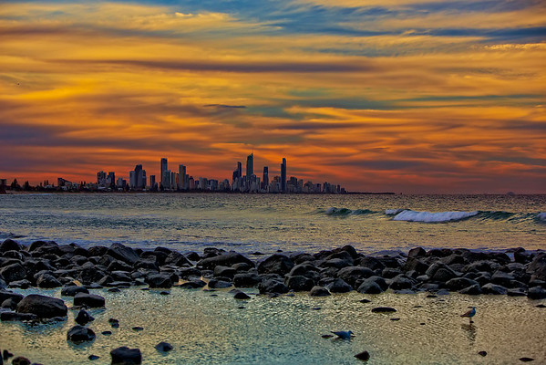 Gold Coast Sunset.  Across the rocks at Burleigh Heads, looking across to Surfers Paradise, Queensland Australia.