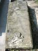 92. Фраґмент поховання XVIII століття (плита з черепом і хрестом).