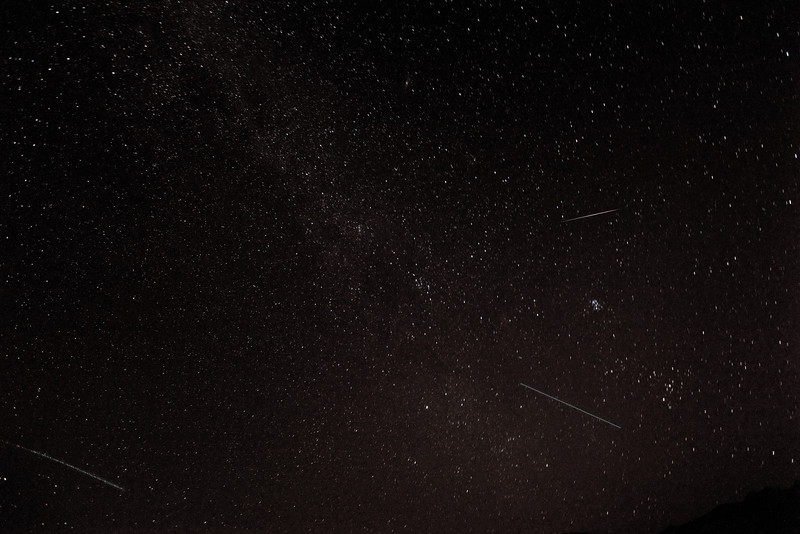 This photograph contains Images of the Perseid Meteor Shower. The stream of debris is called the Perseid cloud and stretches along the orbit of the comet Swift-Tuttle. The cloud consists of particles ejected by the comet as it travels on its 133 year orbit. Most of the particles have been part of the cloud for around a thousand years. The earliest information on this meteor shower is found in Chinese annals in 36 AD.<br /> This photograph was taken on August 12,2013 at 2:12am. The photo is 15.5MB in size.