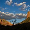 Red Rocks of Sedona. Sunlight and shadows play off the red sandstone buttes, spires and fluted cliff's that surround Sedona, Arizona. Every daylight hour and every season brings new form and color to this crimson backdrop. <br /> This Photograph was taken September 2010 at about 6pm.