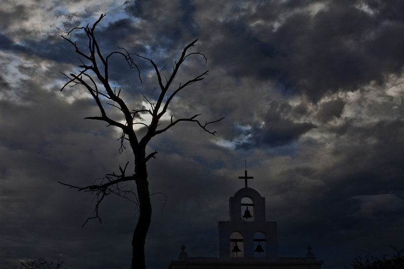 This Photograph was taken on one of my many visits to the San Xavier del Bac Mission. It was late in the day and the cloud cover brought character to the image. The location of this is within feet of the Mission. The Mission is located 10 miles south of downtown Tucson, Arizona on Arizona State Route 19 towards Nogales.