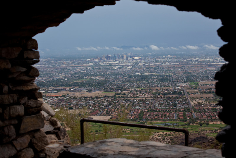 This photograph was taken at South Mountain Park in Phoenix, Arizona. South Mountain Park is the largest city park in the United States. One of the largest urban Parks in North America and in the world. South Mountain Park preserves in a natural state a mountainous area of 16,283 acres. Originally called Phoenix Mountain Park it was formed in 1924 when President Calvin Coolidge sold its initial 13,000 acres to the city of Phoenix for $17,000. Prominent local citizens with the help of Senator Carl Hayden put the purchase together. It has since been expanded through Bond Programs during 1970's into early 1980's. This photograph was taken at Dobbins Lookout. Photographed on September 8,2013 just after a morning rain shower.