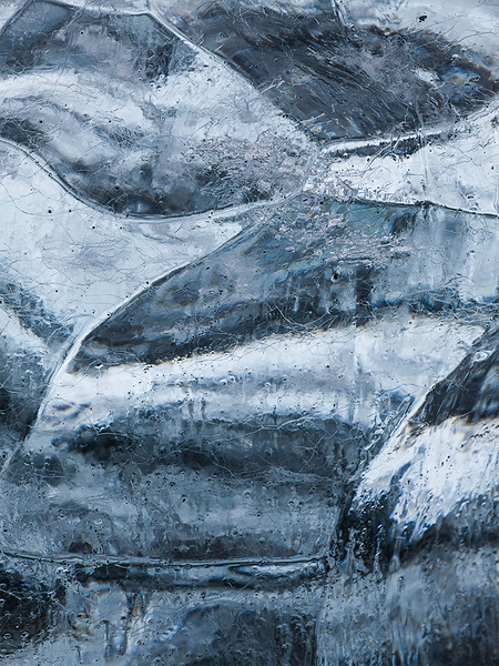Detail of iceberg on black sand beach.