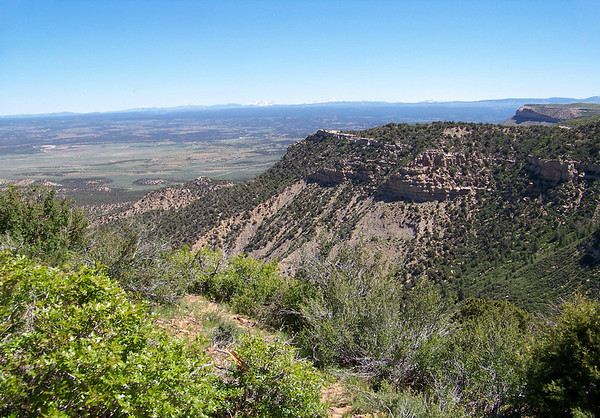 "From the North Rim, across The Knife Edge and Point Lookout - down and across the Montezuma Valley - Mesa Verde National Park (1906) - also a UNESCO, World Heritage Site ""Cultural"" (1978). Mesa Verde translates to ""Green Table"" from the Spanish language."