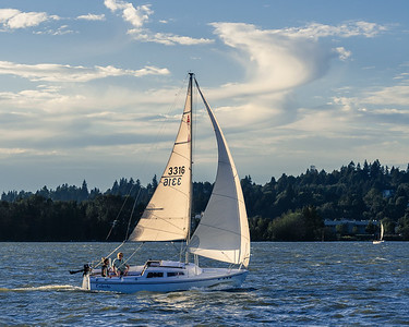Sometimes things just line up perfectly, like the clouds and the sails.  Sailing on a fresh breeze.