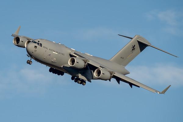 _A739477 - Royal Australian Air Force Boeing C-17A Globemaster III A41-212 banking on approach.