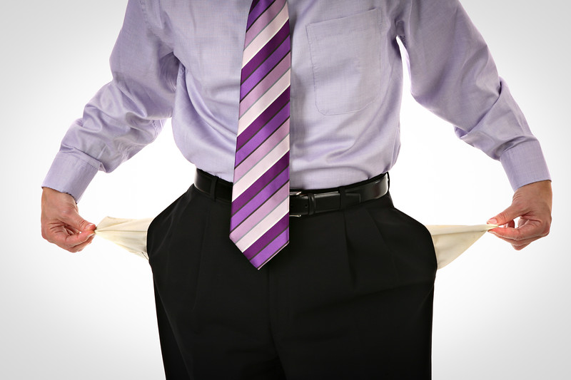 Man Pulling out Empty Pockets on Isolated Background
