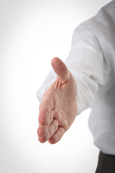 Closeup of Businessman Handshake on Isolated White Background