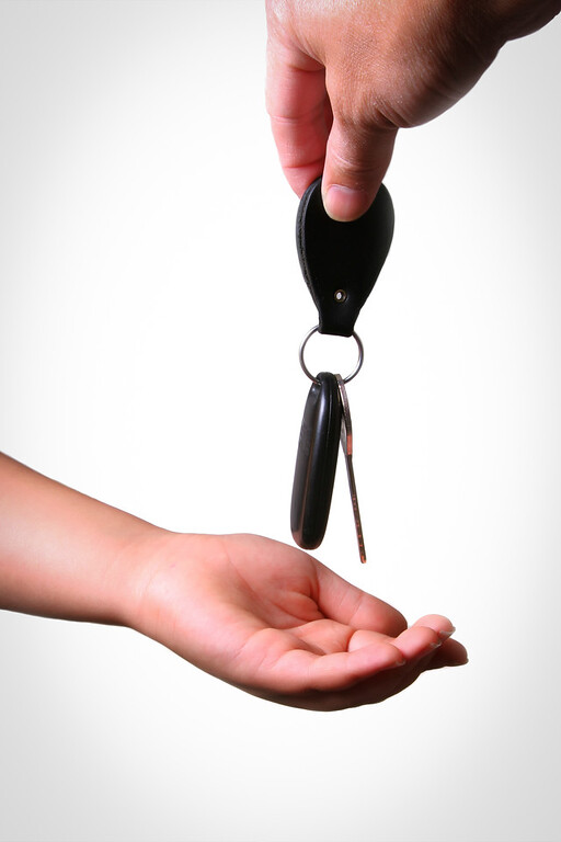 Car Key Hand over to Young Hand