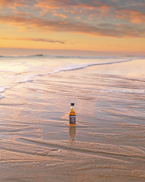 JD Travel Bottle on Textured Sand at Hampton Beach in New Hampshire