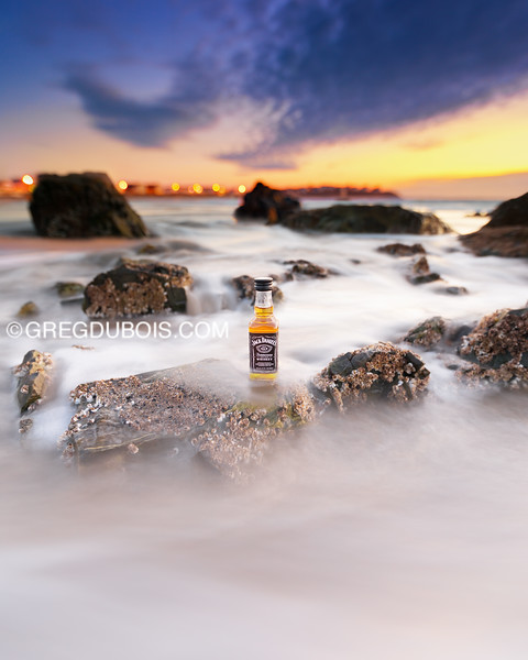 JD Travel Bottle on Sea Rocks at Hampton Beach in New Hampshire