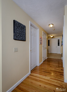 Warm And Welcoming Hallways Lead To The Foyer, Bedrooms, Closet And Bath.