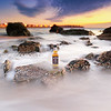 JD Travel Bottle on Sea Rocks at Hampton Beach in New Hampshire