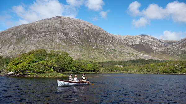 Anglers fly fishing for trout and salmon from a boat, Lough Inagh Connemara Ireland