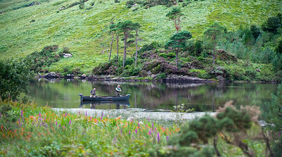 Fly fishing from boat for salmon and sea trout on Finlough Delphi Fishery Connemara, Ireland