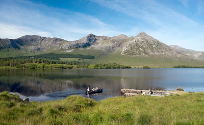 Stunning scenery - trout anglers setting out in boat on Lough Inagh, Connemara, Ireland