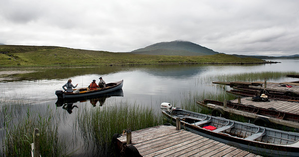 Anglers setting out for a days seatrout and salmon angling in a boat with guide on Lough Inagh Connemara