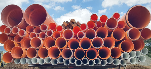 Stacked pipes from a construction site
