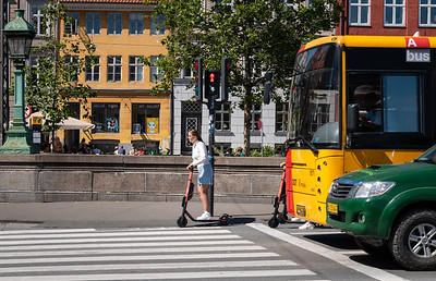 Traffic safety, girl on a scooter, Copenhagen