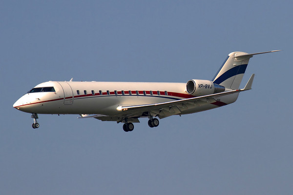 Reg: VP-BVJ Operator: Vacuna Jets Type:  Bombardier Challenger 850 C/n: 8071 Location:  Manchester - Ringway (MAN / EGCC) - UK   The CRJ850 is the corporate/executive version of the original Canadair Regional Jet, marketed by Bombardier as part of the Challnger range of jets. This example is based in Russia and is seen bringing visitors to a football match in Manchester - in tricky afternoon light, with the sun right down the aircraft's nose.     Photo Date: 05 March 2013 Photo ID: 1300601