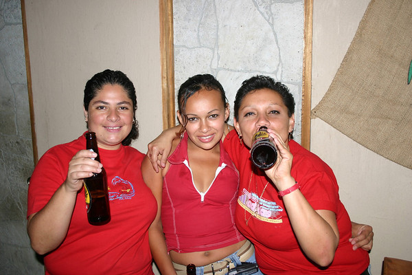 """Tican waitresses at cantina near Cachi town - having an """"Imperial"""" brand beer - known locally as """"aguila"""" or eagle"""