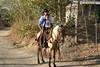 Victor taking his son Paco to escuela (school) - near the village of Nuevo Colon - Nicoya Peninsula (north-west) - Guanacaste province