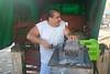 Shredding coconut for sale at the Turrialba Mercado - Cartago province