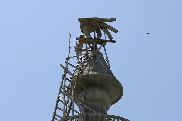 "Frigate bird, soaring - above the concrete sculpture ""pass the J"", atop the Nosara Beach Hotel - Nicoya Peninsula (western) - Guanacaste province"
