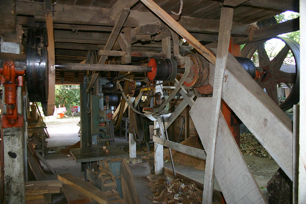The gear-shaft and belt that powers the bandsaw from the waterwheel - at the oxcart factory of Eloy Alfaro and Sons - Sarchi (city)