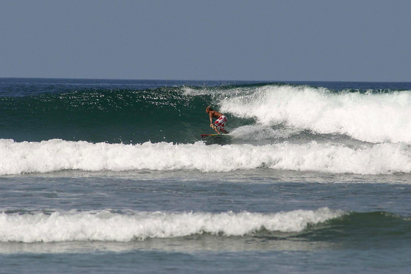 Surfer at Playa Guiones - located along the western coast of the Nicoya Peninsula - Guanacaste province