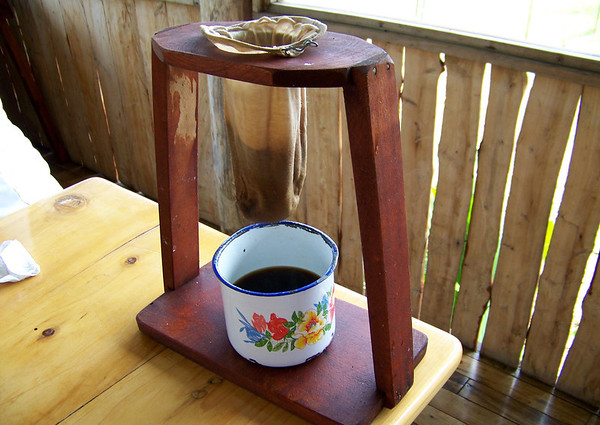 """Chorreador - a Costa Rican coffee pot - chorrear means """"to drip"""" - thus ground coffee beans are placed within a cotton cloth bag supported by a metal wire, and placed upon a wooden frame, then hot water is poured through - thus you have a Tican style cup of Café (spanish for coffee) - about as fresh as it gets"""