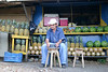 Pablo at his fruit stand (pineapple, cantelope, mango, and watermelon) - in Brujo (town) - Puntarenas province (south)