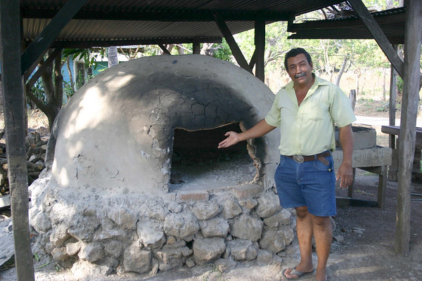 Willy Ramirez - showing me his earthen wood-fired pottery kiln in back of his shop - in town of Guaitil, located in the north-central region of the Nicoya Peninsula - Guanacaste province