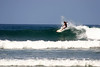 Surfer at Playa Guiones - located along the western coast of the Nicoya Peninsula - Guanacaste province e