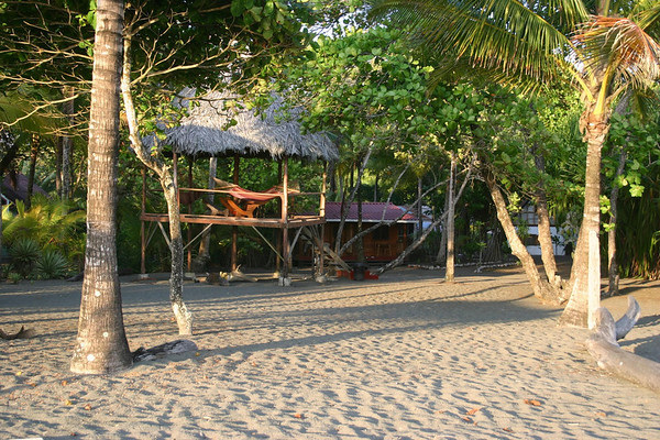 Late afternoon sunlight upon the beach at the coastal village of Zancudo (meaning mosquito) - and my cabina for the night, with a pair of hammocks along the Golfo Dulce - Puntarenas province (south) - near the Panama border